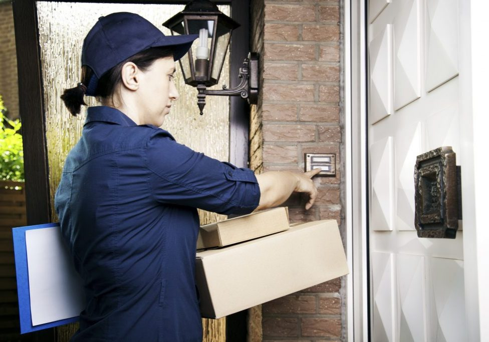Delivery worker delivers packages to customer