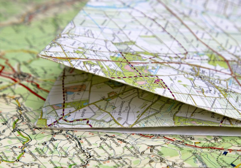 Close up or macro of folded road maps, shallow depth of field